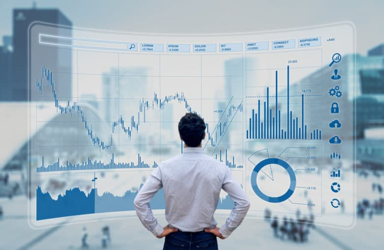 Photo of a trader in front of a stock market dashboard that presents multiple indicators