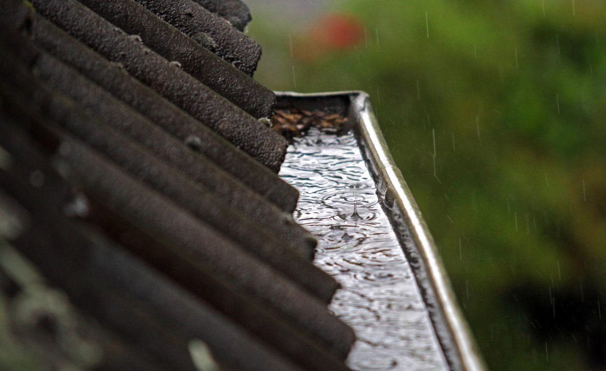 Clogged gutter in heavy rain